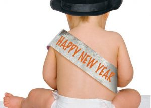 baby wearing happy new year sash