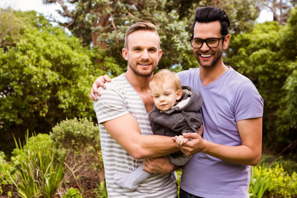 gay couple with surrogate baby