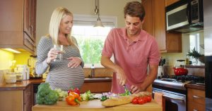 Cute pregnant couple in the kitchen